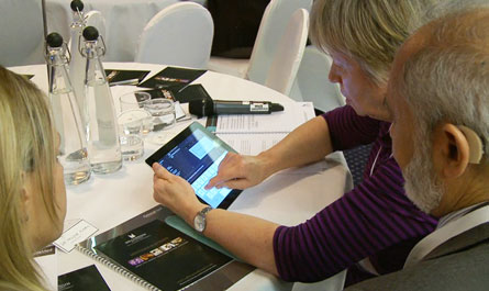 An image of a delegate using an iPad